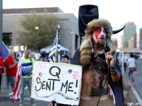 A Qanon believer speaks to a crowd of President Donald Trump supporters outside of the Maricopa County Recorder's Office where votes in the general election are being counted, Phoenix, November 5, 2020.