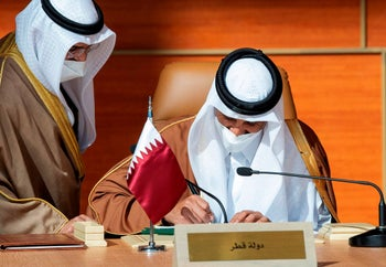 Qatar's ruler, Sheikh Tamim bin Hamad Al-Thani, signing a document as part of the Gulf reconciliation, January 5, 2021.