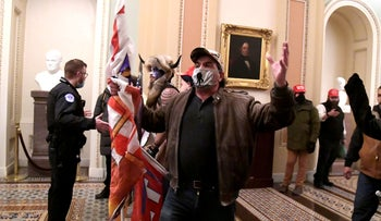 Supporters of President Donald Trump demonstrate on the second floor of the U.S. Capitol near the entrance to the Senate after breaching security defenses, in Washington, U.S., January 6, 2021.