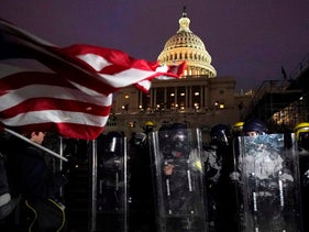 Police stand guard after a day of riots at the U.S. Capitol in Washington, January 6, 2021.