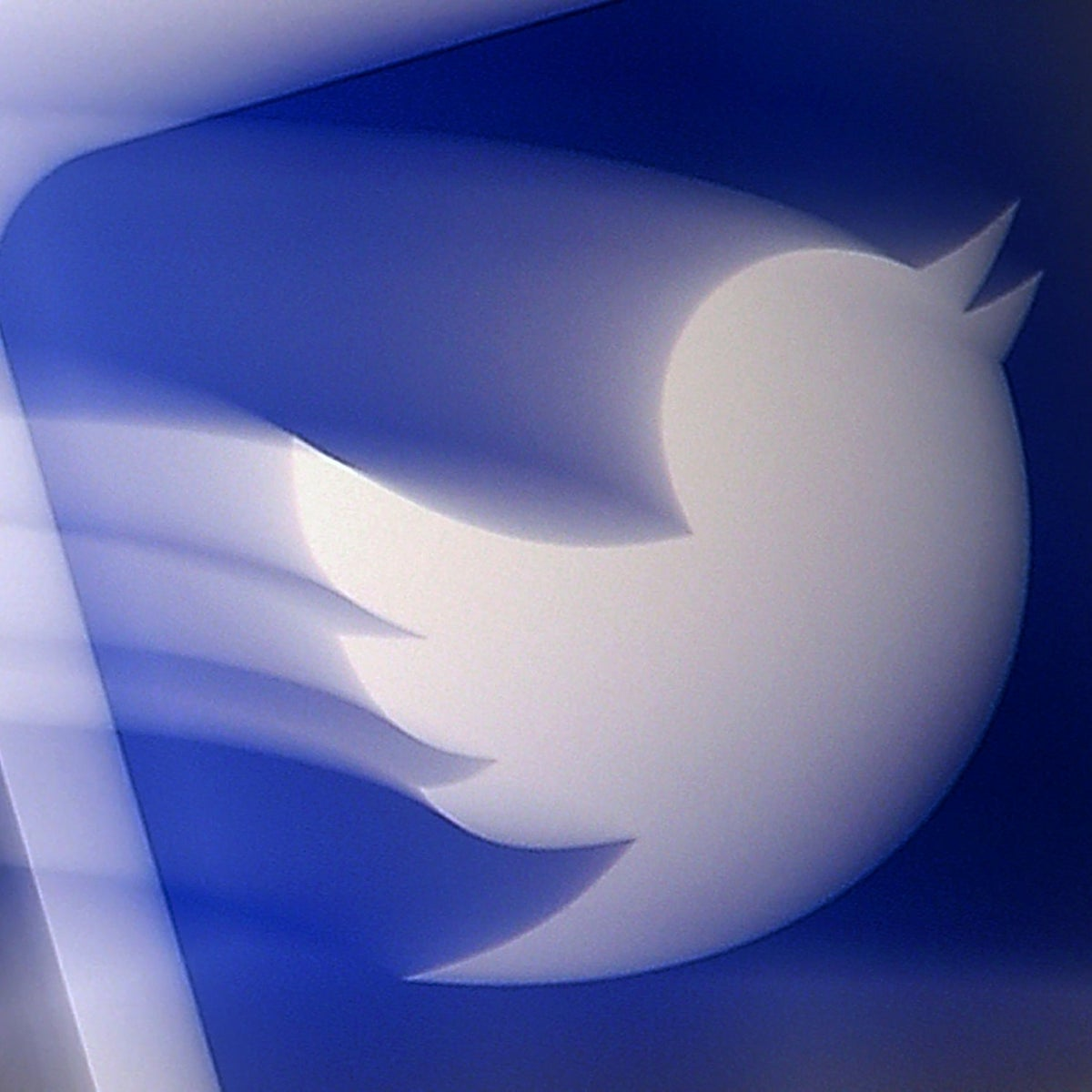 A Twitter logo is displayed on a mobile phone in Arlington, Virginia, August 10, 2020.