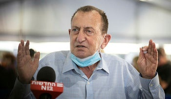 Tel Aviv Mayor and Founder of Hayisraelim party Ron Huldai addresses media at a Tel Aviv vaccination center, December 2020.