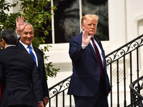 Prime Minister Benjamin Netanyahu smiling as he walks next to President Donald Trump outside of the White House during the signing of the Abraham Accords, September 2020.