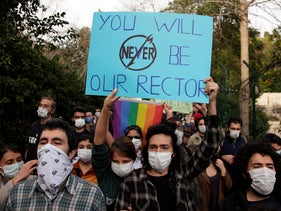 Students of Bogazici University hold placards during a protest in Istanbul, January 6, 2021.