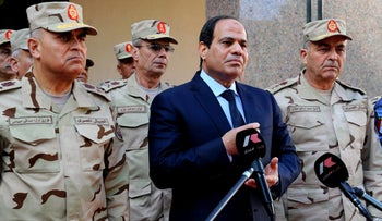 A handout picture released by the Middle East News Agency (MENA) shows Egyptian President Abdel-Fattah el-Sisi (C), surrounded by top military generals, as he addresses journalists following an emergency meeting of the Supreme Council of the armed Forces in Cairo on January 31, 2015.
