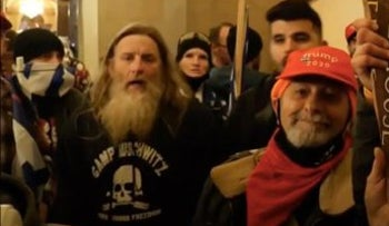 """A U.S. Capitol rioter wearing a """"Camp Auschwitz"""" sweatshirt appeared in footage from ITV, a British television channel, and has since been identified as Robert Keith Packer, January 7, 2021."""