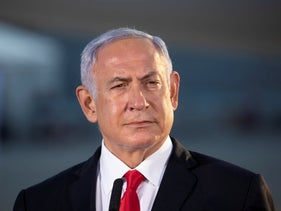 Benjamin Netanyahu at Ben Gurion International Airport as a plane with doses of Pfizer's COVID-19 vaccine arrives, January 10, 2021.