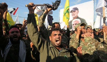 Hashed al-Shaabi paramilitary force chant anti-US slogans during a protest over the killings of Iranian commander Qassem Soleimani and Iraqi paramilitary commander Abu Mahdi Al-Muhandis, in Karrada in central Baghdad, January 6, 2020