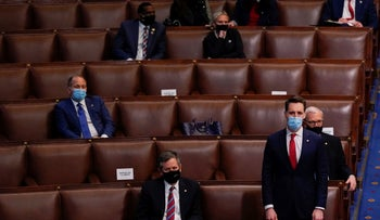 Sen. Josh Hawley, R-Mo., rises to join House Republican members to object to confirming the Electoral College votes from Pennsylvania, January 7, 2021.