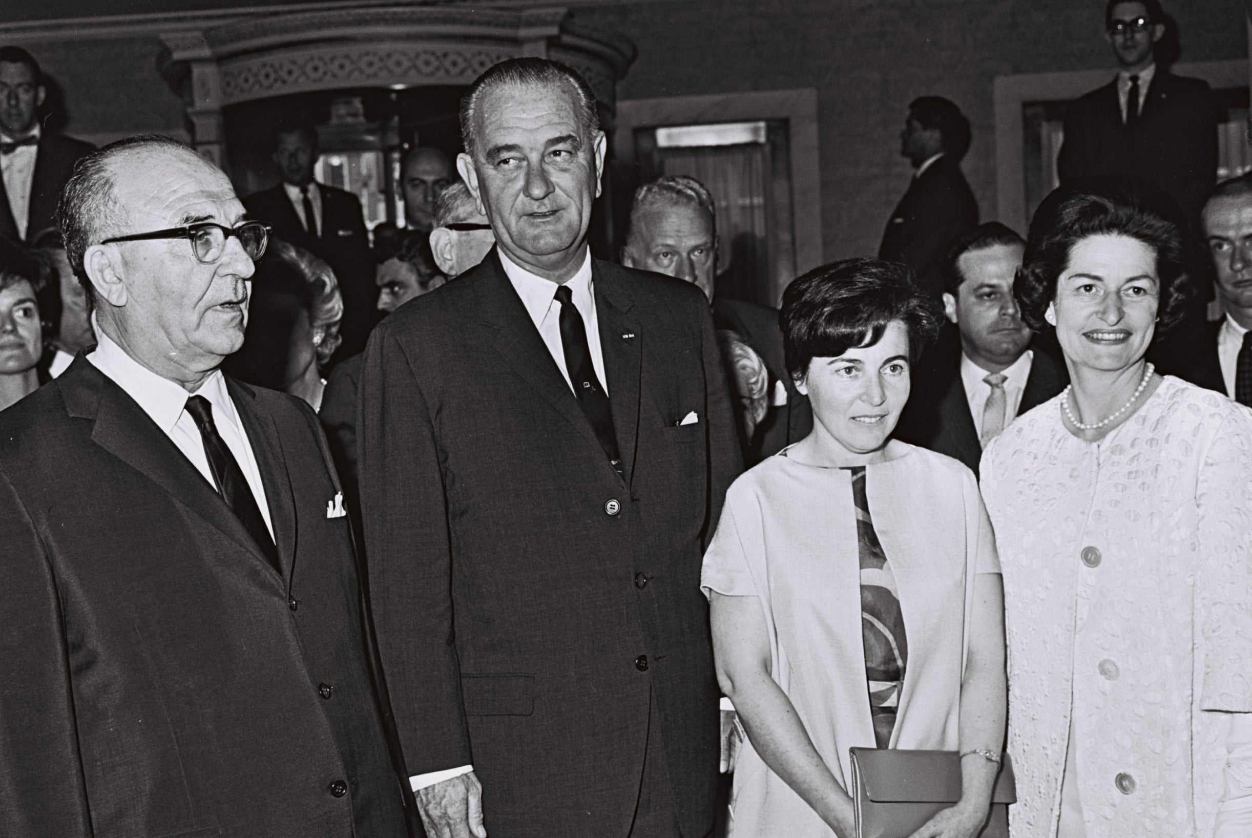 Israeli Prime Minister Levi Eshkol, left, U.S. President Lyndon B. Johnson and their wives at a reception in Washington, June 1964.