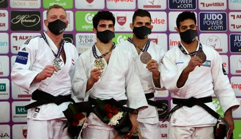 (L-R) Netherlands' Frank De Wit, Georgia's Tato Grigalashvili , Bulgaria's Ivaylo Ivanov and Israel's Sagi Muki stand on the podium of the men's under 81kg category of the World Judo Masters in the Qatari capital Doha, on January 12, 2021.
