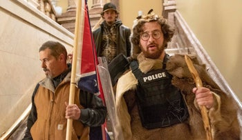 Supporters of Donald Trump, including Aaron Mostofsky, right, walk down the stairs outside the Senate Chamber in the U.S. Capitol, January 6, 2021.