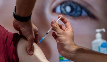 A coronavirus vaccine is administered in Jerusalem, January 11, 2021.