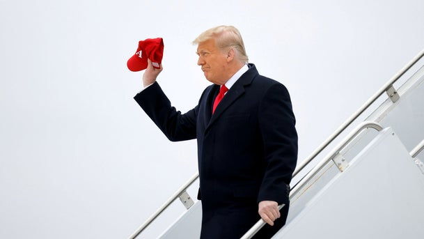 U.S. President Donald Trump disembarks from Air Force One during a visit to the U.S.-Mexico border wall, in Harlingen, Texas, January 12, 2021.