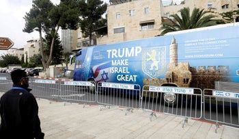 A bus decorated with Israeli and U.S. flags and a message welcoming the move of the U.S. embassy to Jerusalem, in Jerusalem, May 13, 2018.