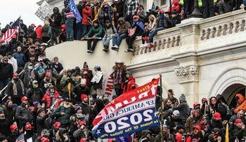 Rioters in support of U.S. President Donald Trump gather at the west entrance of the Capitol during a protest outside of the Capitol building in Washington D.C. U.S. January 6, 2021.