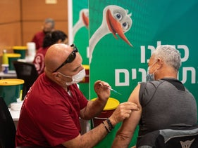 A patient receiving the COVID-19 vaccine at Expo Tel Aviv, January 13, 2021.
