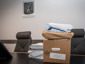 File photo: Documents are seen on a table at the Tel Aviv District Court.