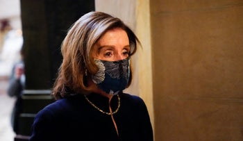Speaker of the House Nancy Pelosi returns to her leadership office from the House chamber at the Capitol in Washington, January 13, 2021.