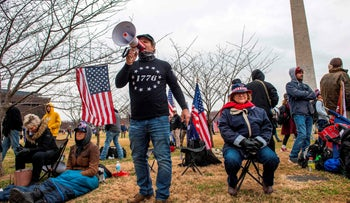 A man calls for the storming of the U.S. Capitol building at a rally that evolved into a violent siege by Trump supporters that left five dead, Washington, D.C., January 6, 2021.