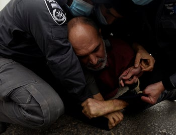 Police detain a protester at a demonstration against Netanyahu's Nazareth visit, January 13, 2021.