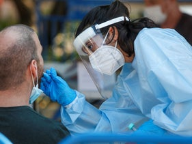 A man is tested for COVID-19 at a testing station in Rabin Square in Tel Aviv.