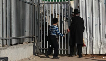 The entrance to the Grodno Yeshiva in Ashdod, Israel, where clashes with police took place after it was opened against coronavirus regulations, January 13, 2021.