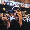A dervish from the Sufi Bektashi order performing a mystical ritual, in the town of Prizren, in Kosovo.