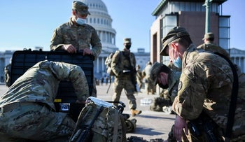 National Guard members deploy on U.S. Capitol grounds, after U.S. President Donald Trump was impeached for a second time, in Washington, U.S. January 14, 2021