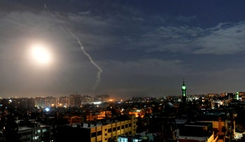 Missiles flying into the sky near the international airport in Damascus, Syria, Jan. 21, 2019.