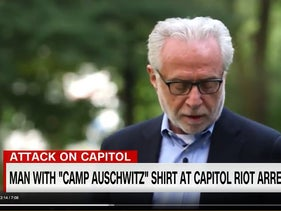 Wolf Blitzer says Kaddish at Auschwitz during a 2014 visit for a documentary