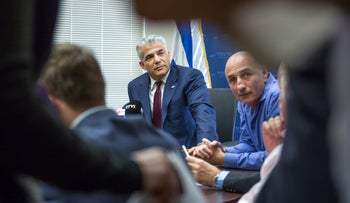 Yair Lapid, left, and Ofer Shelah in 2017, when Shelah as well was in Yesh Atid.