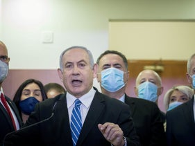 Prime minister Benjamin Netanyahu delivers a statement to the media ahead of the first hearing in his corruption trial, Jerusalem, May 24, 2020.