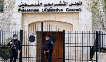 Members of the Palestinian security forces guard the Legislative Council building in Ramallah, January 16, 2021.