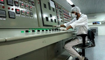 A technician works at the Uranium Conversion Facility just outside the city of Isfahan, Iran, 410 kilometers south of the capital Tehran, 2007.