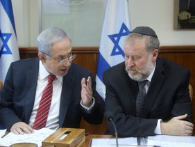 Prime Minister Netanyahu, left, and Attorney General Avichai Mendelblit at a cabinet meeting in Jerusalem, 2015.