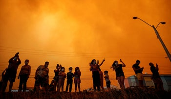 Residents watch a forest first move closer in Quilpue, Chile, January 15, 2021.