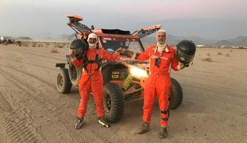 Driver Danny Pearl and co-driver Charly Gotlib, stand by their Lightweight Vehicle Prototype, as they take part in the Dakar Rally, Saudi Arabia, January 8, 2021.