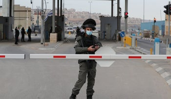 An Israeli Border Police officer standing guard at the Qalandiyah checkpoint in the West Bank, December 7, 2020.