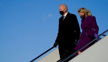 President-elect Joe Biden with his wife Jill Biden as they arrive at Andrews Air Force Base, Tuesday, Jan. 19, 2021.