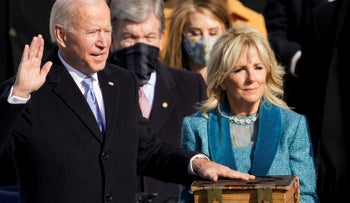 Joe Biden is sworn in as the 46th President of the United States as his spouse Jill Biden holds a bible on the West Front of the U.S. Capitol in Washington, U.S., January 20, 2021.