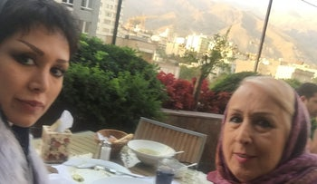 Mania Darbani and her mother Maryam Taghdissi Jani are seen in a restaurant in Tehran, Iran, 2017.