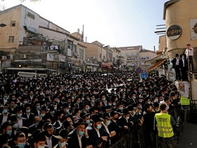 Ultra-Orthodox Jews attend a mass funeral for Rabbi Aharon David Hadash, spiritual leader of Jerusalem's Mir Yeshiva, one of the largest in Israel, amid the coronavirus pandemic. December 3, 2020.