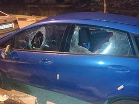 A car that was the target of stones thrown by Israeli settlers in the West Bank, January 21, 2021.