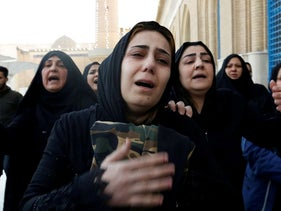 Women mourn during the funeral of a man who was killed in a twin suicide bombing attack in a central Baghdad market, in Baghdad, Iraq January 21, 2021.