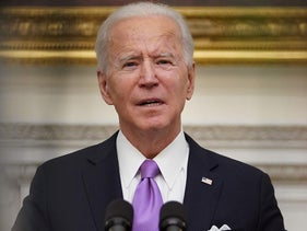 U.S. President Joe Biden speaks  before signing executive orders in the State Dining Room of the White House in Washington, DC, on January 21, 2021.