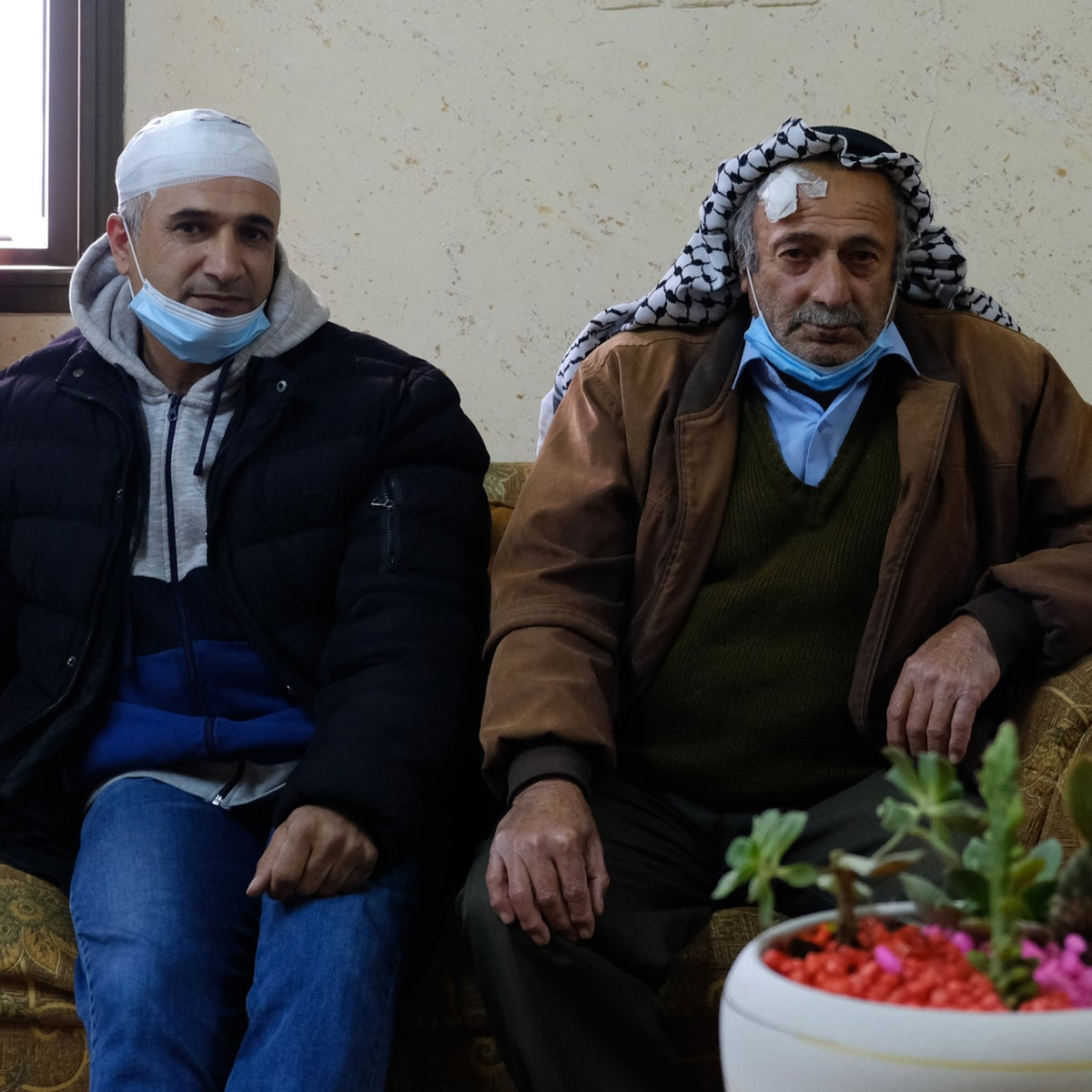 Izz a-Din Zinadin, left, and his father Mohammed, this week. After they filed a complaint, the investigator told them to go home and wait for a call. It's unlikely to come.