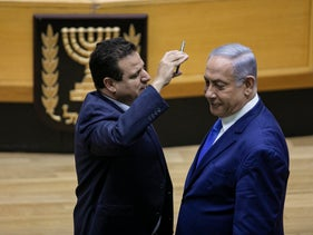 Prime Minister Benjamin Netanyahu and Joint List chairman Ayman Odeh at the Knesset, Jerusalem, September 11, 2019.