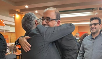 Newly elected leader of Balad, Abu Shahadeh hugs outgoing leader Mtanes Shahadeh after receiving the results from the primaries, January 2021.