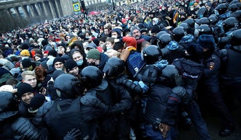 People clash with police during a protest against the jailing of opposition leader Alexei Navalny in St.Petersburg, Russia, Saturday, Jan. 23, 2021